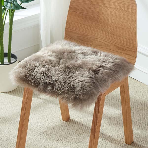 Australian Sheepskin Fur Chair Pad to a lounge or bedroom setting.