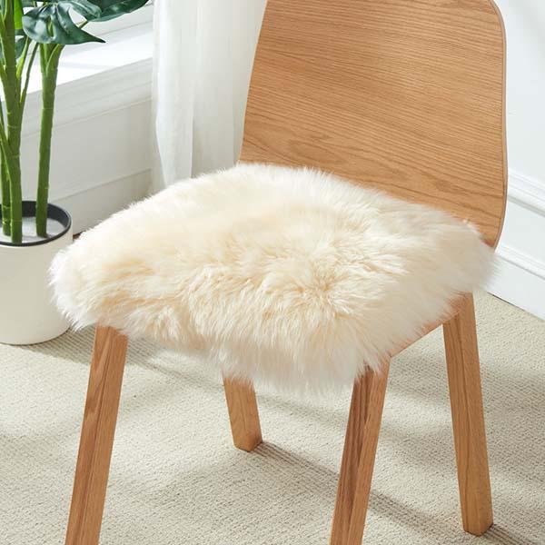 white Australian Sheepskin Fur Chair Pad to a lounge or bedroom setting.