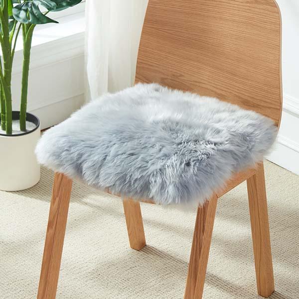blue Australian Sheepskin Fur Chair Pad to a lounge or bedroom setting.